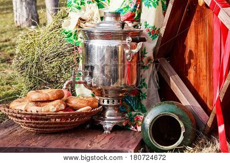 Traditional Russian samovar and a bunch of bagels