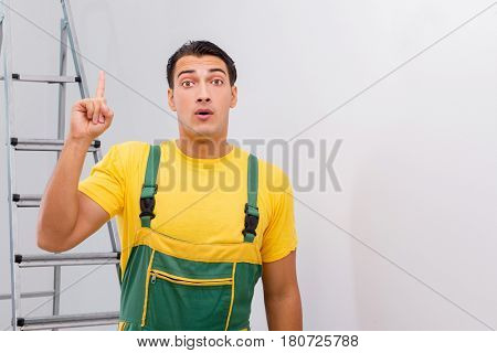 Repairman in coveralls in DIY concept poster