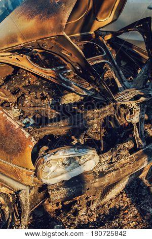 Burned vehicle on parking lot abandoned stolen car