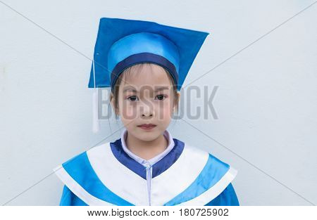 Cute Asian Kids With Graduation Robe. Educational Concept. Copy Space.