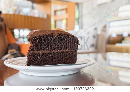Double Chocolate Cake On The Table In Cafe With Copy Space, Coffee Time Concept.