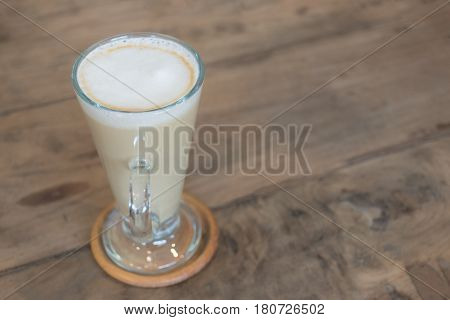Cup Of Coffee On Soft Green Sofa In The Coffee Shop. Coffee Cup Relaxation Concept.