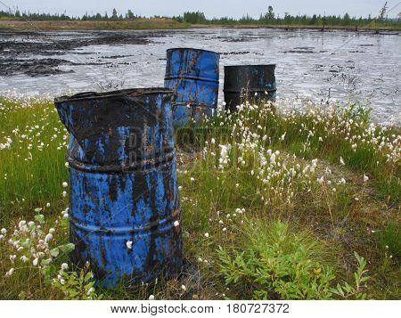 Dump of old oil barrels. environmental pollution