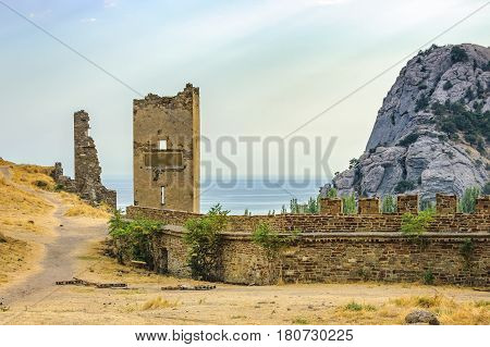 Walls of Genoese fortress in Sudak Crimea. Scenic views of rocky cliffs near ancient Genoese fortress and the Black Sea