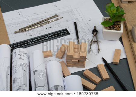 Workplace Of Architect - Model House From Wooden Blocks, Construction Drawings, Engineering Tools
