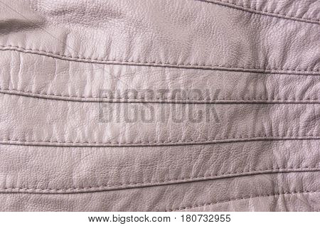 texture beige leather jacket with seams, close-up