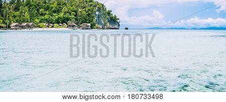 Coastline with Homestay on Kri Island, Raja Ampat, Indonesia, West Papua