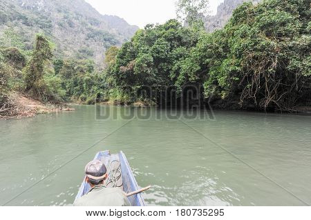 People Traveling In A Canoe On The River