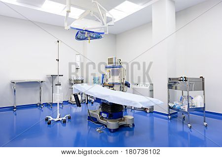 Empty operating-table is among different medical equipment in operation-room