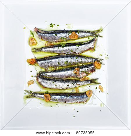 Anchovies Marinated In Olive Oil, Cooked At A Low Temperature.