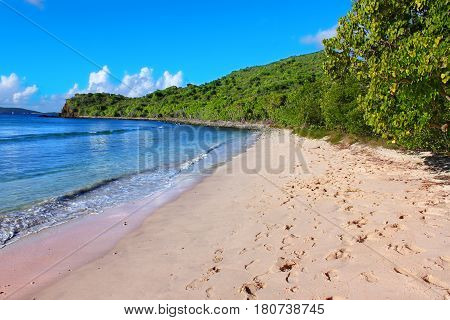 Sandy beaches on the Caribbean island of Tortola are a popular vacation destination.