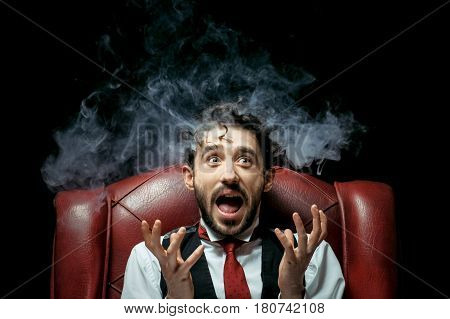 Stressed businesswoman with smoke coming out of his ears