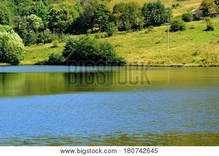 Lake. Landscape in Apuseni Mountains, Transylvania. The Apuseni Mountains is a mountain range in Transylvania, Romania, which belongs to the Western Romanian Carpathians