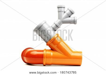 New grey and orange drain pvc pipe isolated on white