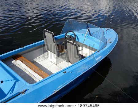 The old motor boat on the water