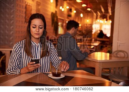 Lovely Millennial Looking At Her Cellphone