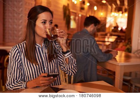 Millennial Looking Dreamily While Drinking Tea