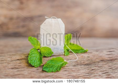 Tea Bags On Wooden Background With Fresh Melissa, Mint. Tea With Mint Concept
