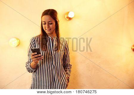 Pretty Millennial Reading A Ceelphone Message