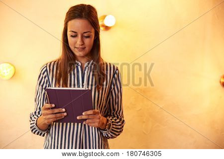 Smiling Young Millennial With Her Tablet