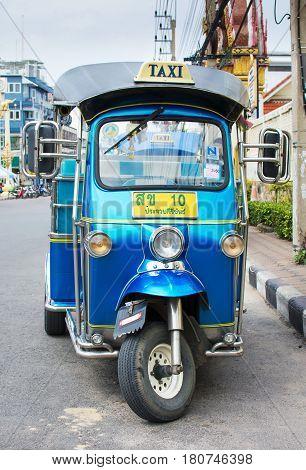 Hua Hin, Thailand - October 24, 2016: Thailand Famous Taxi Tuk Tuk Vehicle On A Street