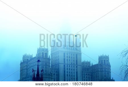 Beautiful view of the main building of the Moscow University in the blue mist photograph close-up