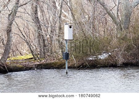 A birdhouse sticks out of the water at Belmont Lake State Park Long Island New York