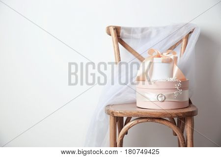Wooden chair with gift boxes for wedding day