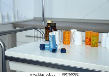 Asthma inhalers and medications on table