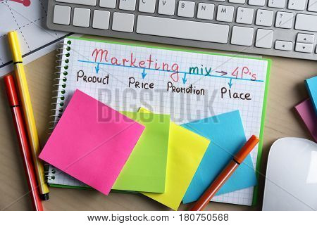 Stationery and computer on table. Marketing concept