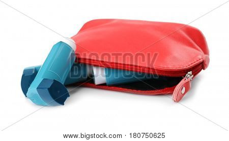 Cosmetic bag with asthma inhalers on white background