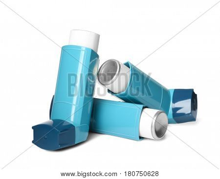 Asthma inhalers on white background