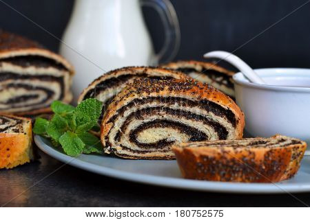Homemade roll with poppy seeds and milk for breakfast
