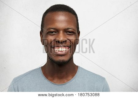 Happy Young African American Man Smiling Cheerfully Showing His Perfect Straight White Teeth At Came