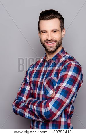 A Semi Portrait Of Handsome Bearded Smiling Man In Checkered Shirt Isolated On Gray Background