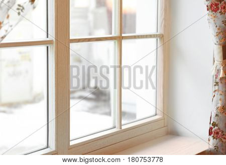 Large wooden window with beautiful curtains in sunny day