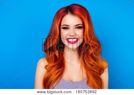 Close-up Of Attractive Cute Girl With Long Ginger Fair Hair With Toothy Beaming Smile While Standing