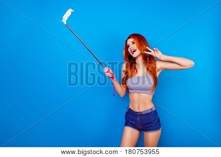 Portrait Of Glad Charming Stylish Funny Girl With Ginger Hair And Cute Face Make Selfie Photo With S