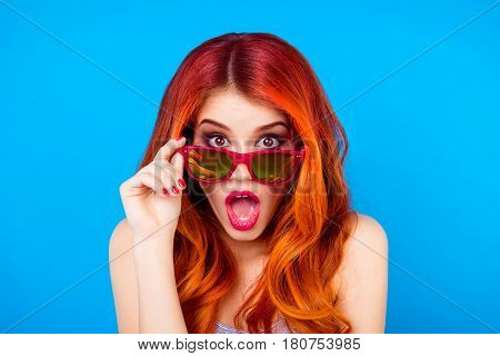 Surprised Shocked Girl With Beautiful Red Curly Long Hair Holding Sunglasses And Open Mouth While St