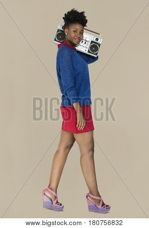 African Descent Woman Holding Jukebox