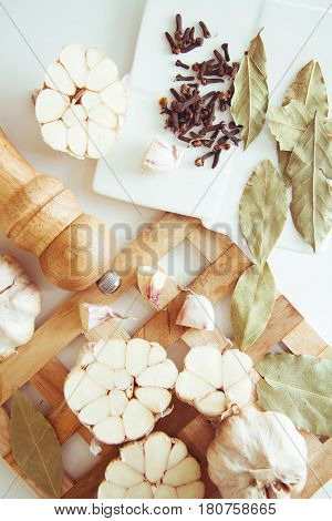 halves of garlic flavouring vegetable for cooking