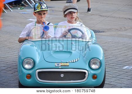 LE MANS FRANCE - JUNE 13 2014: Children on sports cars on Parade of pilots racing in Le Mans France