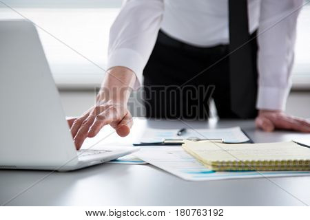 Businessman working with computer in an office. Close-up