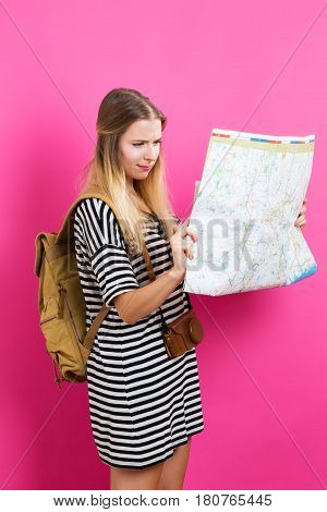 Young Traveling Woman Holding A Map