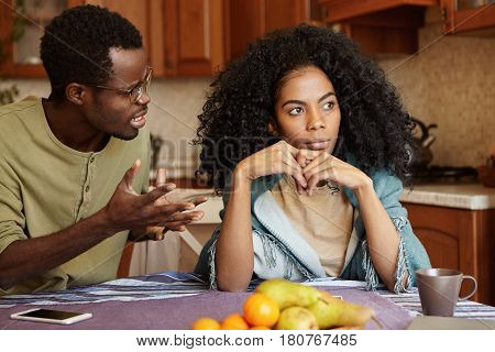 Furious Black Male Gesturing In Despair Or Anger While Trying To Make Excuses To His Offended Wife A