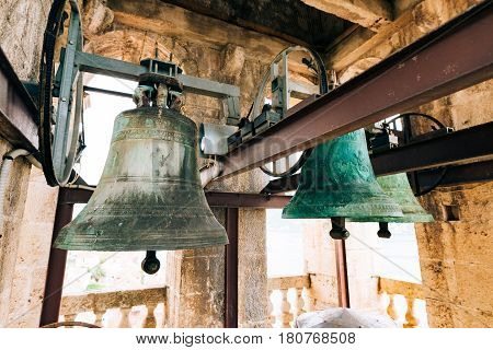 The bells in the chapel. Vintage old large bells in the bell tower near the church, in Croatia and Montenegro.
