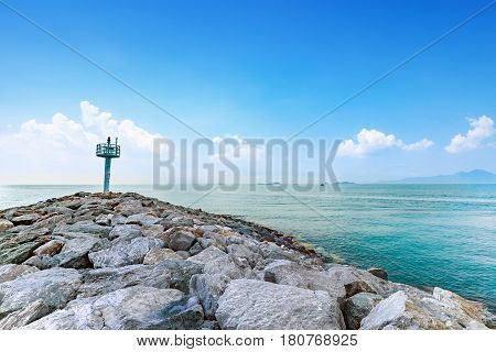 calmness seashore with warning tower and bright blue sky at Rayong Province Eastern of Thailand