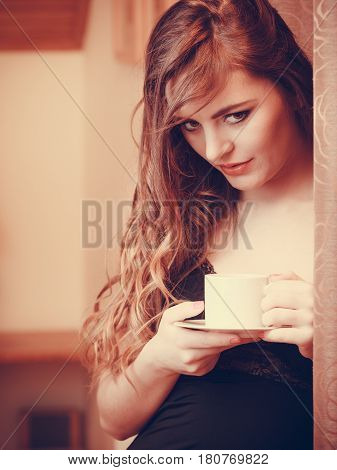 Woman Drinking Hot Coffee Beverage At Home
