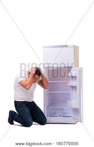 Man looking for food in empty fridge