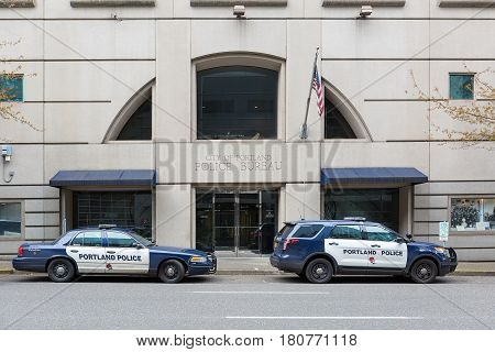 PORTLAND OREGON - APRIL 9 2017: City of Portland Police Bureau Sports Utility Vehicle SUV and patrol cruiser car parked outside city downtown metro station